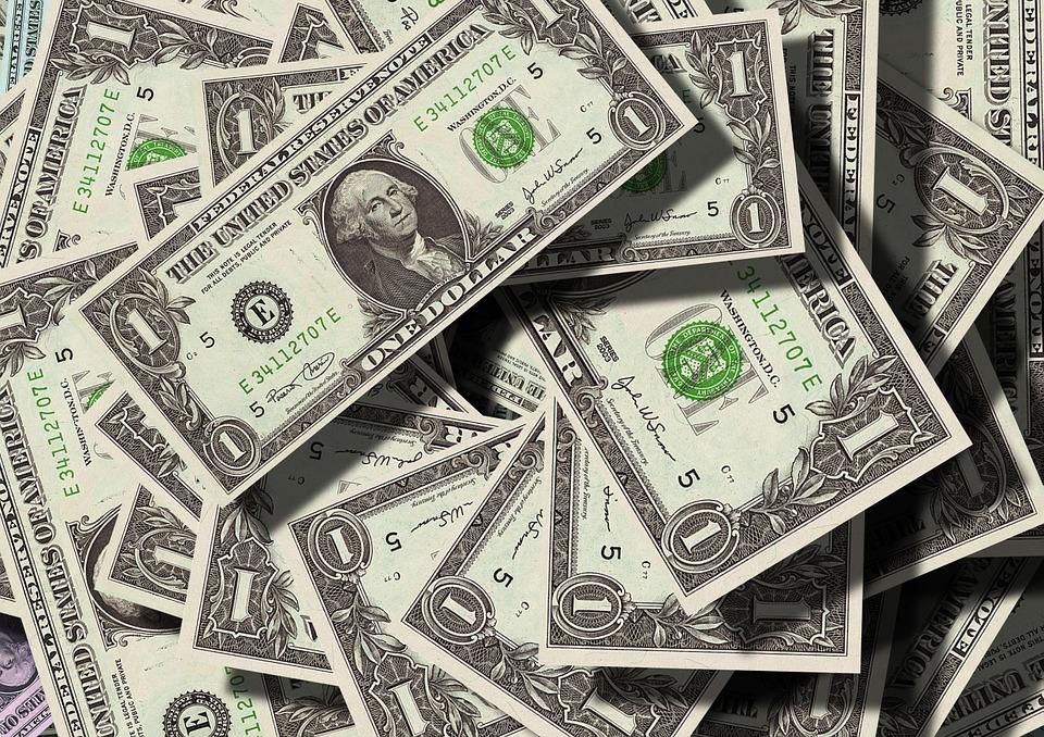 American dollar bills in a pile